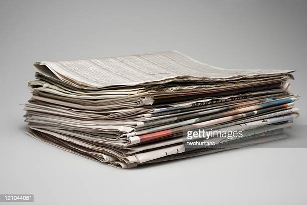 A stack of morning business papers