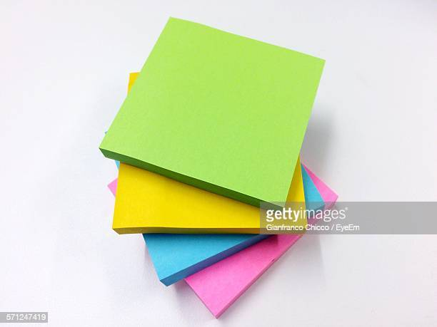 Stack Of Multi Colored Adhesive Notes Against White Background