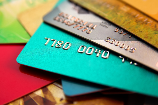 stack of multicolored credit cards, close up view with selective focus 1137281183
