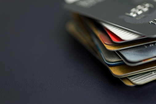 Stack of multicolored credit cards close-up 903663312