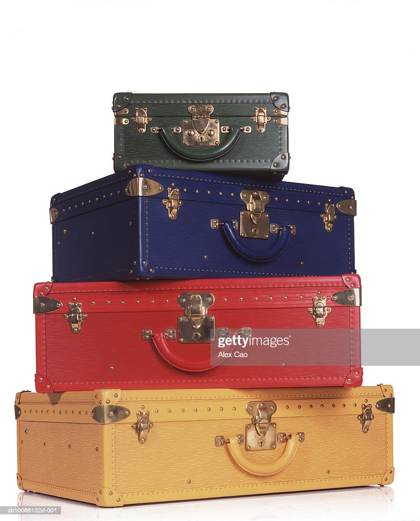 Stack of multicolored suitcases : Stock Photo