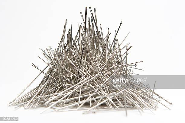 stack of needles - sewing needle stock pictures, royalty-free photos & images