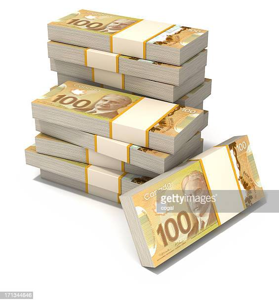 stack of new canadian dollar bills. - canadian dollars stock pictures, royalty-free photos & images