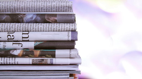 stack of newspaper 908385546