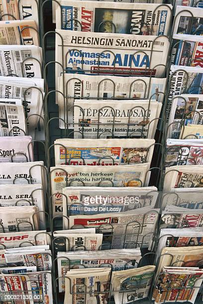 stack of newspapers in rack, elevated view - news stand stock pictures, royalty-free photos & images
