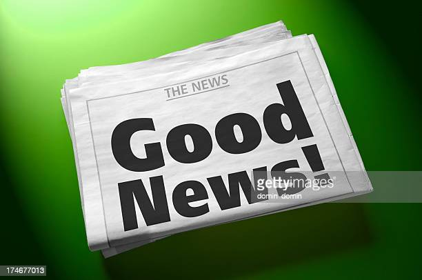 stack of newspapers with headline good news! on green background - good news stock pictures, royalty-free photos & images