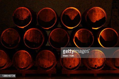 stacked oak barrels maturing red wine. Keywords Stacked Oak Barrels Maturing Red Wine A