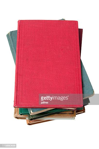 Stack of old books on white background with path