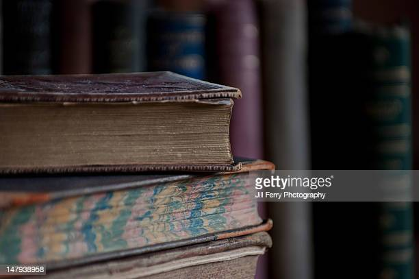 stack of old books - old book stock photos and pictures