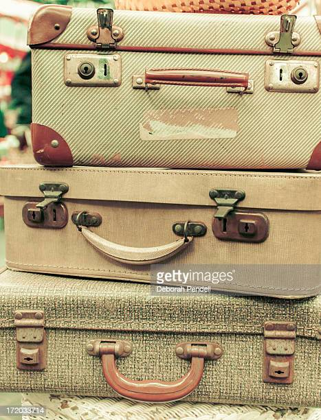 A stack of old fashioned vintage suitcases