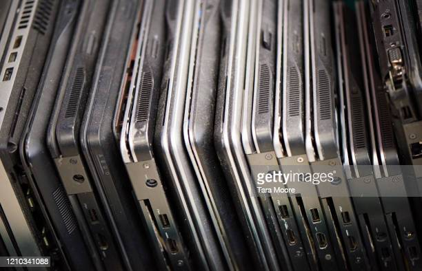 stack of old laptops - femalefocuscollection stock pictures, royalty-free photos & images