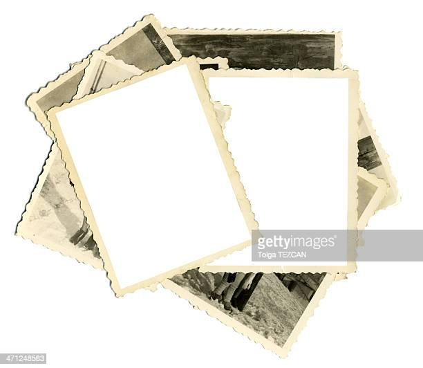Stack of old photos with two blank on top