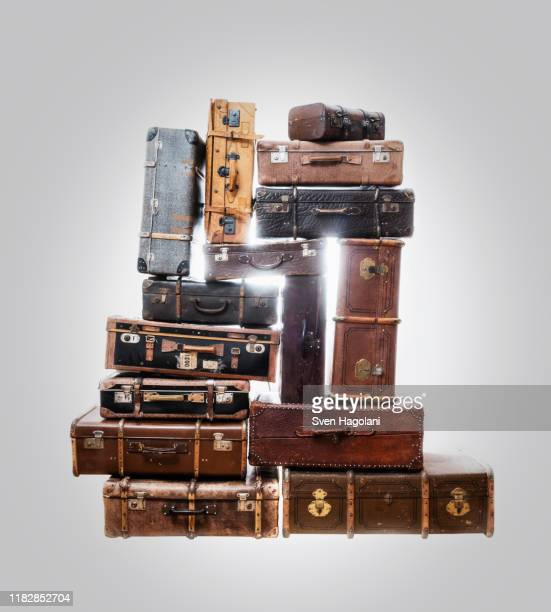 stack of old suitcases over gray background - large group of objects stock pictures, royalty-free photos & images