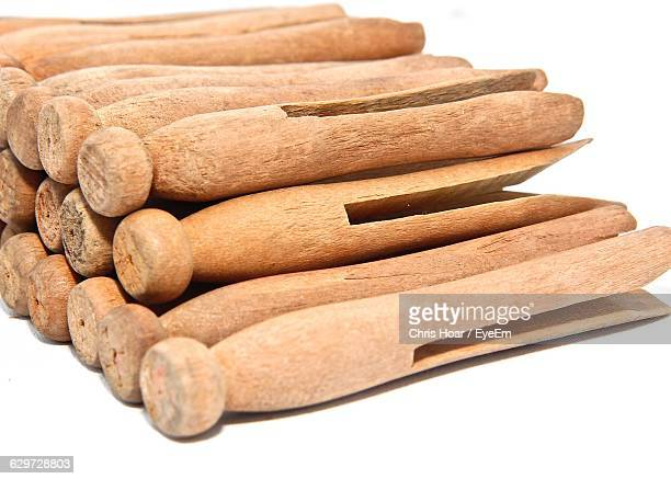 stack of old-fashioned clothespins on white background - clothespin stock pictures, royalty-free photos & images