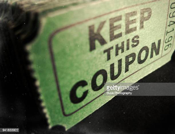 a stack of old-fashioned us coupons - coupon stock pictures, royalty-free photos & images