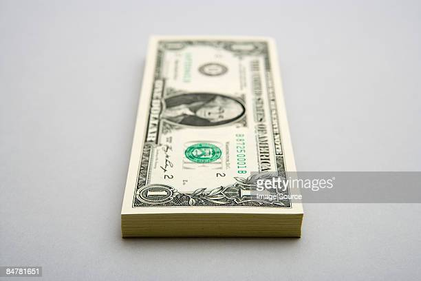 stack of one dollar bills - american one dollar bill stock pictures, royalty-free photos & images