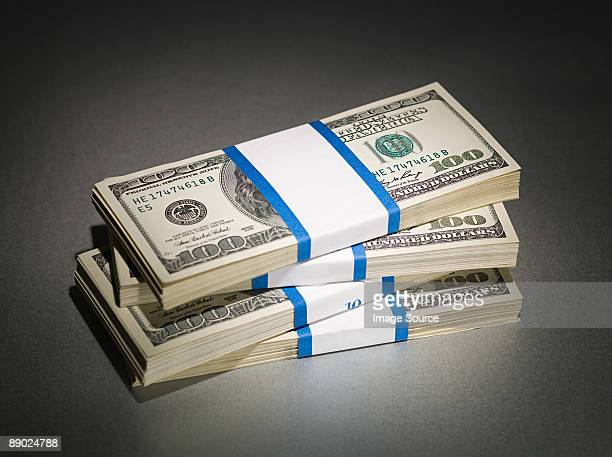 stack of one hundred dollar bills - recessed lighting stock pictures, royalty-free photos & images