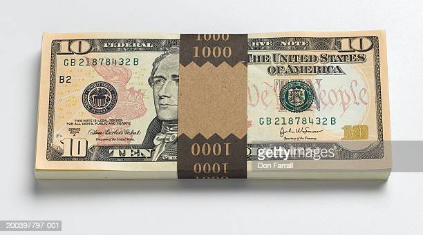 Stack of one hundred US ten dollar bills, elevated view