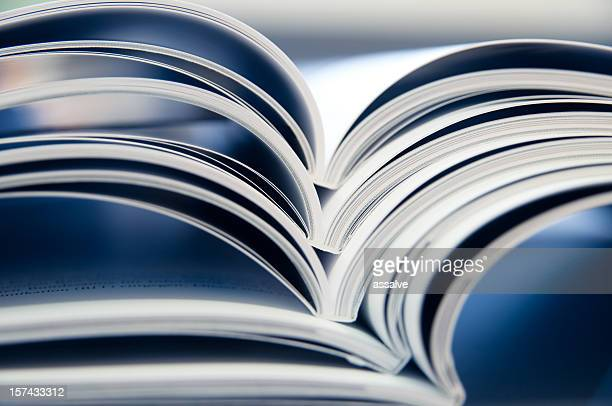 stack of open magazines - publication stock pictures, royalty-free photos & images