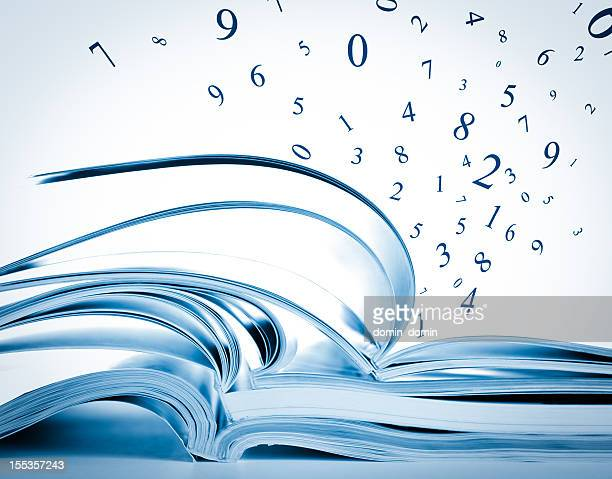stack of opened books, magazines, exercise notebooks with flying numbers - magazine page stock photos and pictures