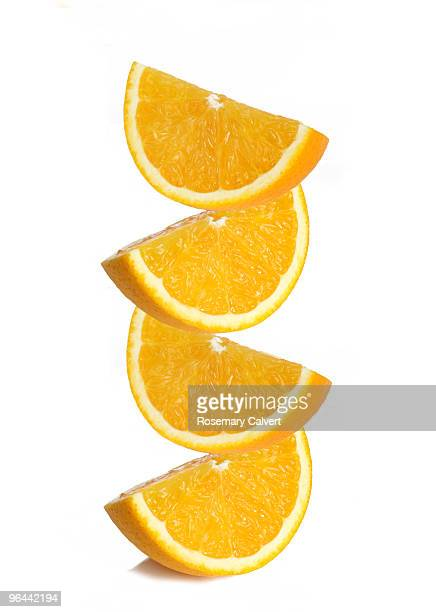Stack of orange segments, white background.