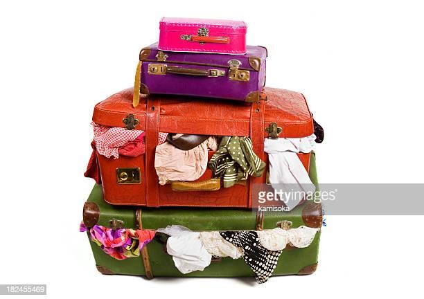 Stack Of Overstuffed Luggage
