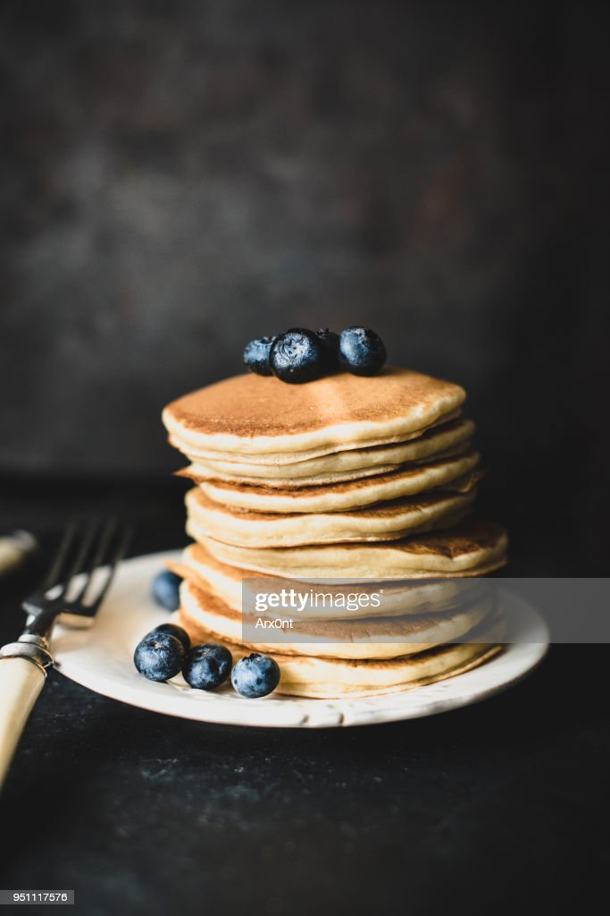 Stack of pancakes with blueberies on dark background : Stock Photo