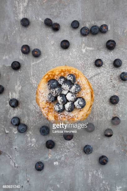 Stack of Pancakes with blueberries and powdered sugar