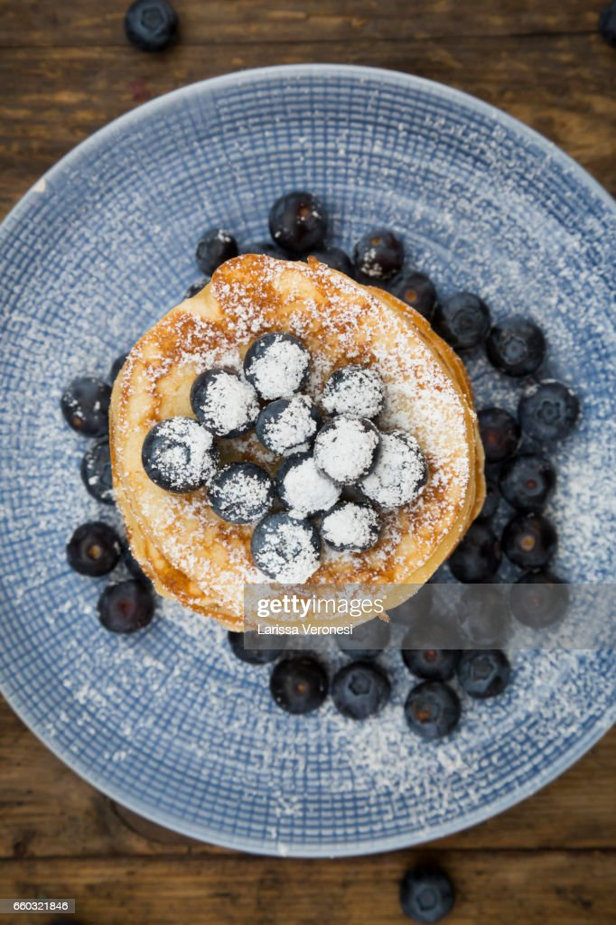 Stack of Pancakes with blueberries on blue plate : Stock Photo