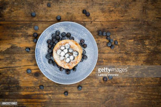 Stack of Pancakes with blueberries on blue plate