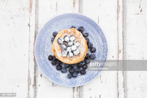 Stack of Pancakes with blueberries on plate