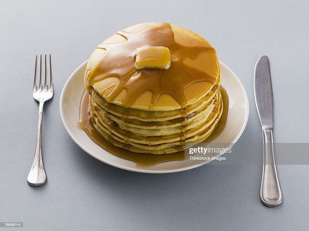 Stack of pancakes with butter and syrup on a plate : Stock Photo