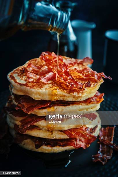 stack of pancakes with crispy bacon and maple syrup - pancakes stock pictures, royalty-free photos & images