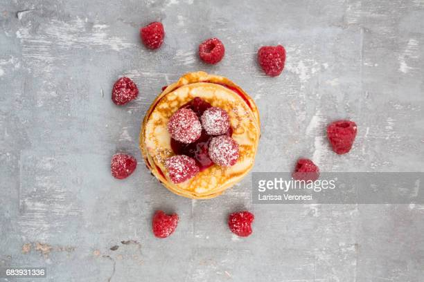 stack of pancakes with raspberry sauce and raspberries - larissa veronesi stock pictures, royalty-free photos & images