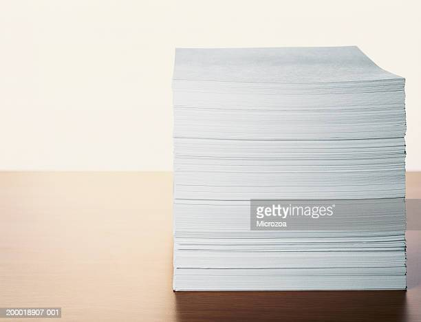 stack of paper on table, close-up - microzoa stock pictures, royalty-free photos & images
