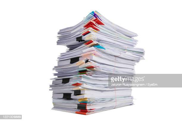 stack of papers on white background - 束 ストックフォトと画像
