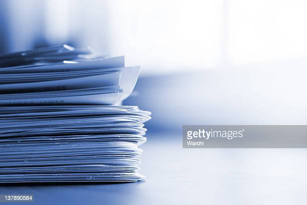 Stack of papers with blue tint