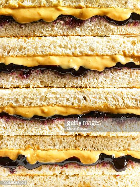 stack of peanut butter and jelly sandwiches, close-up - peanut butter and jelly sandwich stock pictures, royalty-free photos & images