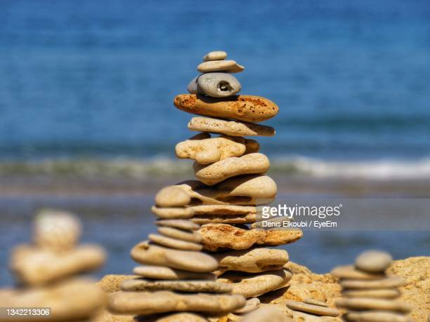 stack of pebbles on beach - netanya stock pictures, royalty-free photos & images