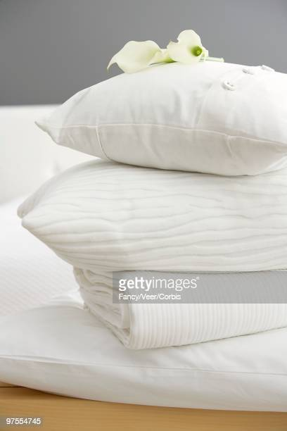 Stack of pillows and blanket