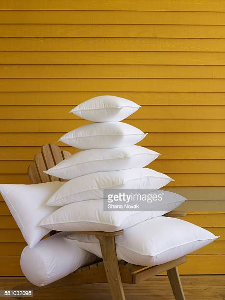 stack of pillows on adirondak chair - pillow stock pictures, royalty-free photos & images