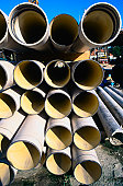 Stack of pipes on building site.