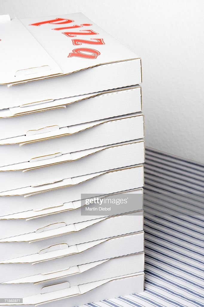 Stack of pizza boxes on table : Stock Photo