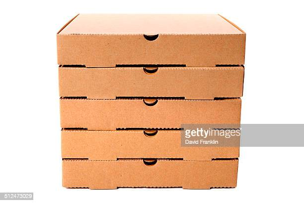 Stack of plain brown pizza boxes