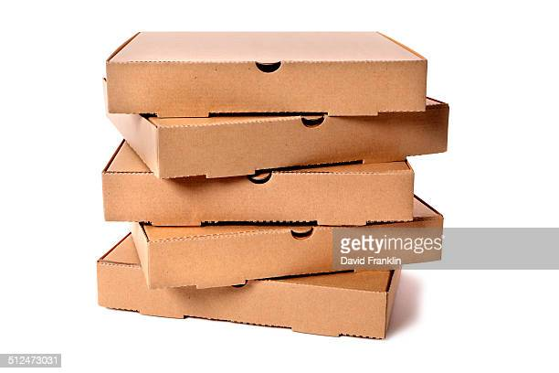 stack of plain brown pizza boxes - pizza box stock photos and pictures