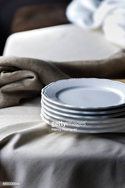 Stack of plates on tablecloth