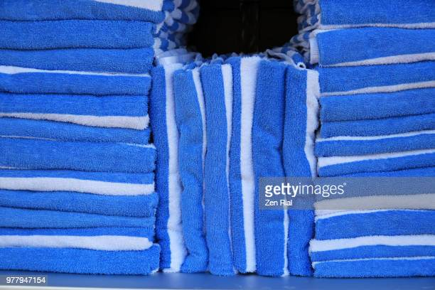 stack of pool towels in blue and white colors - zen rial stock photos and pictures