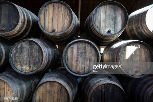 stack of port wine barrel in a wine cellar - whisky photos et images de collection
