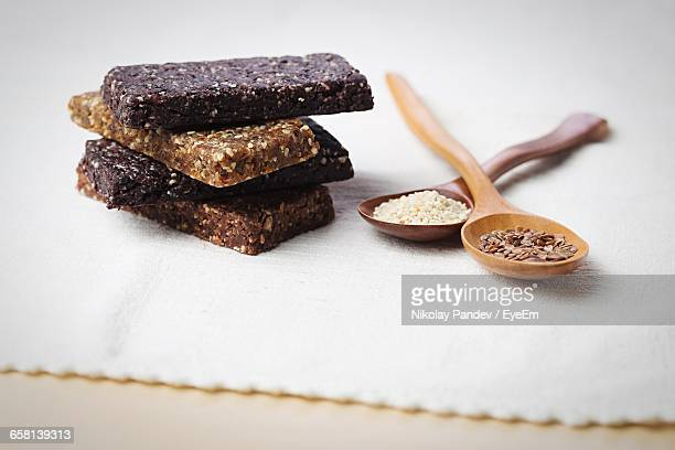 Stack Of Protein Bars With Food Ingredients On Table