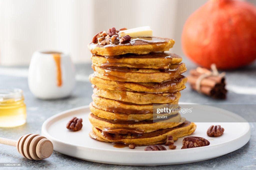 Stack of pumpkin pancakes with caramel sauce : Stock Photo